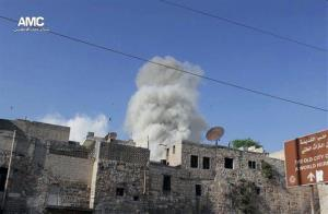 This April 27, 2014, photo from the anti-government activist group Aleppo Media Center, which has been authenticated, shows smoke rising from a Syrian government forces airstrike in Aleppo, Syria.