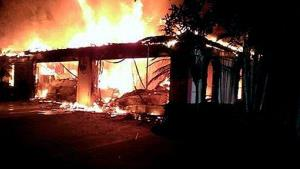 In this photo provided by the Hillsborough County Sheriff's Office, flames destroy a mansion owned by former tennis star James Blake.