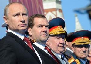 Russian President Vladimir Putin, left, and Prime Minister Dmitry Medvedev attend the Victory Day parade in Moscow. Putin later went to Crimea.