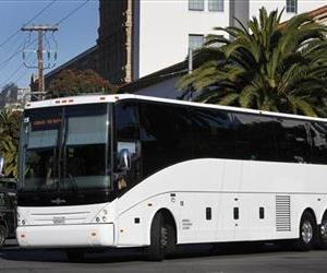 In this June 14, 2013 photo, a Google shuttle bus arrives at 18th and Dolores streets to pick up employees in San Francisco.