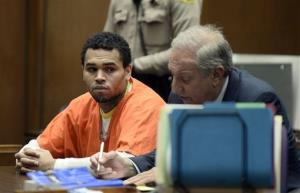Chris Brown, left is shown in court with his attorney, Mark Geragos Friday May 9, 2014 in Los Angeles.