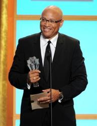 Larry Wilmore accepts the best talk show award for The Daily Show with Jon Stewart at the Critics' Choice Television Awards in 2013.