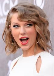 Taylor Swift arrives at the 49th annual Academy of Country Music Awards at the MGM Grand Garden Arena on Sunday, April 6, 2014, in Las Vegas.