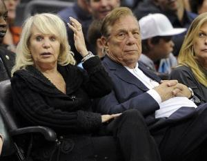 Los Angeles Clippers owner Donald Sterling, right, sits with his wife Shelley  during a game against the Detroit Pistons.