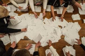 Members of an election committee count ballots after voting closed at a polling station in Donetsk, Ukraine, Sunday, May 11, 2014.