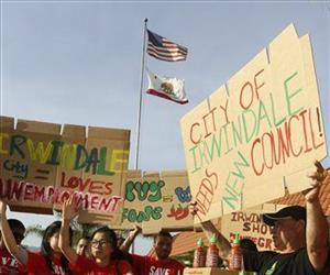 Sriracha hot sauce supporters protest ahead of the city council meeting in Irwindale, Calif., Wednesday, April 23, 2014.