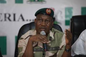 Brig. Gen. Chris Olukolade, Nigeria's top military spokesman, speaks during a press conference on the abducted school girls in Abuja, Nigeria yesterday.