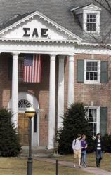 In this 2012 photo, students leave the Sigma Alpha Epsilon fraternity at Dartmouth College in Hanover, NH.