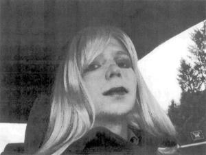 Pfc. Chelsea Manning poses for a photo wearing a wig and lipstick.