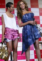 Beyonce, right, and her sister Solange Knowles pose for photographers during a promotional event for Japanese fashion brand Samantha Thavasa at Tokyo Disneyland hotel in Urayasu, Japan, Aug. 10, 2009.