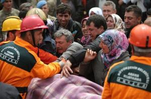 Rescue workers carry the body of a miner outside the mine in Soma, some 155 miles south of Istanbul, early Wednesday, May 14, 2014.