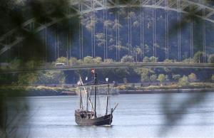 A replica of the Nina, one of the ships of Christopher Columbus' first voyage to America, moves up the Ohio River in this Sept. 20, 2012, file photo.