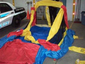 This photo provided by the South Glens Fall Police Department shows the deflated bounce house.