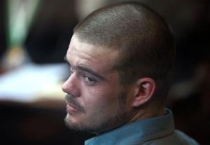 Joran van der Sloot looks back from his seat during his murder trial in Lima, Peru.