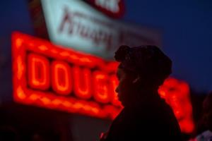 Burger King employee Keisha King, 23, stands during a protest outside a Krispy Kreme store, Thursday, May 15, 2014, in Atlanta. Calling for higher pay and the right to form a union without retaliation, fast-food chain workers in Atlanta protested Thursday as part of a wave of strikes and protests...