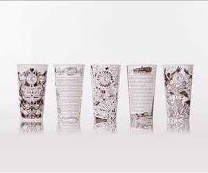 Chipotle cups featuring microfiction from famous authors are seen in this promotional image.