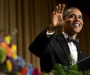 President Barack Obama gestures and smiles during his speech at the White House Correspondents' Association (WHCA) Dinner at the Washington Hilton Hotel, May 3, 2014.