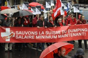Demonstrators in favor of the proposed minimum wage in Switzerland march in Geneva in this file photo.