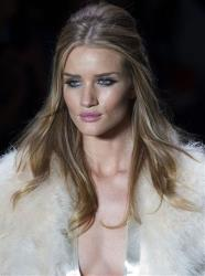 British model and actress Rosie Huntington-Whiteley wears a creation by Animale during Sao Paulo Fashion Week, in Sao Paulo, Brazil, Thursday Jan. 19, 2012.