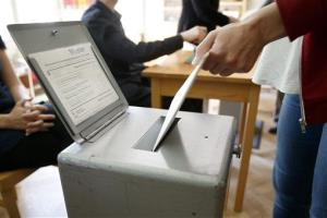 Voters cast ballots in Bern, Switzerland, Sunday, May 18, 2014. Swiss voters voted on a referendum to introduce the world's highest minimum wage of $24.70 an hour.