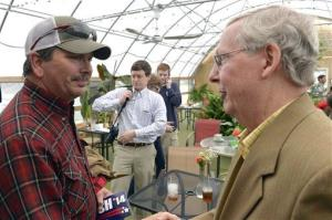 Darrell Uhls, left, shakes hans with Kentucky Republican senatorial candidate Mitch McConnell during a campaign stop Saturday, May 17, 2014, at the Tanglewood Farms Restaurant in Franklin, Ky.