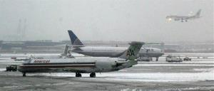 One plane lands as others are serviced at Newark Liberty International Airport, Monday, Feb. 3, 2014, in Newark, NJ.