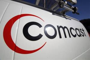 The Comcast logo on one of the company's vehicles.