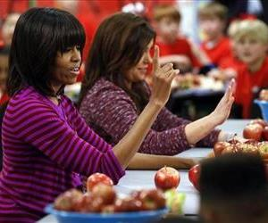 This Feb. 27, 2013 file photo shows first lady Michelle Obama and Food Network chef Rachel Ray discussing lunches with students from the Eastside and Northside Elementary Schools in Clinton, Miss.