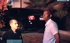 In this image taken from video from OnScene.tv, actor Michael Jace, right, is detained by police outside his home in Los Angeles.