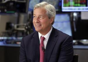 In this July 12, 2013 file photo, JPMorgan & Chase Co. Chairman and CEO Jamie Dimon is interviewed on the floor of the New York Stock Exchange.