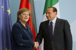 This is a Wednesday, Jan. 12, 2011 file photo of German Chancellor Angela Merkel and Italian Prime Minister Silvio Berlusconi at the chancellery in Berlin, Germany.