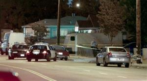 Los Angeles County sheriff's deputies block off the scene of a triple homicide.