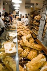 This 2010 file photo shows customers standing in line for bread in New York.