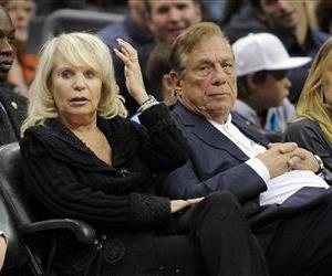 In this 2010 file photo, Los Angeles Clippers owner Donald T. Sterling sits with his wife, Shelly, during a game.