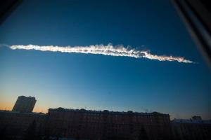 In this Feb. 15, 2013, photo, the meteor flies over the Ural Mountains' city of Chelyabinsk, Russia.