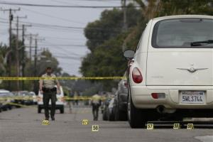 Markers are placed at the scene of a shooting on Saturday, May 24, 2014, in Isla Vista, Calif.