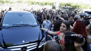 Fans crowd outside Forte Belvedere in Florence, Italy, Saturday, May 24, 2014.