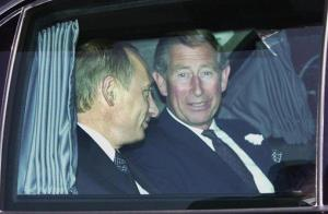 This is a June 26, 2003 file photo of Russian President Vladimir Putin as he shares a limousine with Prince Charles in London, during a visit to Britain.