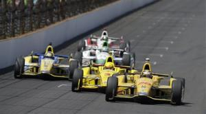 Ryan Hunter-Reay (28) takes the lead from Helio Castroneves, of Brazil, on the white flag lap during the Indianapolis 500.