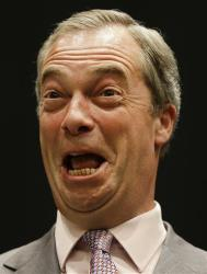 Nigel Farage, leader of Britain's UK Independence Party (UKIP) smiles on stage as he hears election results.