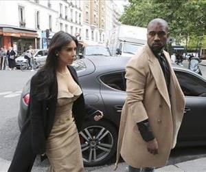 Kim Kardashian and U.S rap singer Kanye West arrive at a luxury shop in Paris, Wednesday, May 21, 2014.