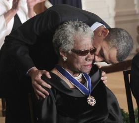 This Feb. 15, 2011 file photo shows President Obama kissing author and poet Maya Angelou after awarding her the 2010 Medal of Freedom.