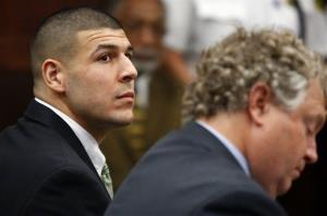 Former New England Patriots tight end Aaron Hernandez listens to the prosecution's summary of facts as he is arraigned on homicide charges at Suffolk Superior Court in Boston Wednesday.