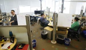 Software engineers work in a cluster of desks at Google Inc.'s new campus in Kirkland, Wash., Wednesday, Oct. 28, 2009.