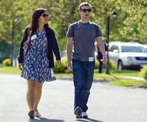 In this July 9, 2011, file photo, Mark Zuckerberg, president and CEO of Facebook, walks to morning sessions with his then girlfriend Priscilla Chan.