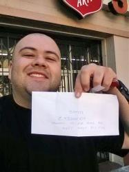 This image provided by Sergio Loza shows Loza holding up an envelope that had cash hidden in it in San Francisco, on Sunday, May 25, 2014.
