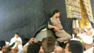 A Saudi police officer takes a break in a bad spot.