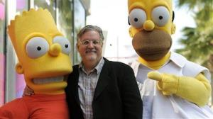 In this Feb. 14, 2012 file photo, Matt Groening, creator of the animated series The Simpsons, poses with his character creations Bart Simpson, left, and Homer Simpson.