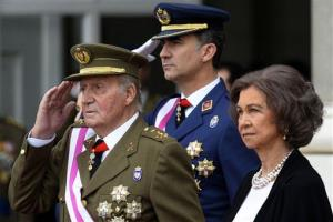 In this Monday, Jan. 6, 2014, file photo, Spain's Crown Prince Felipe, center, King Juan Carlos, left, and Queen Sofia, right, attend a ceremony at the Royal Palace in Madrid, Spain.