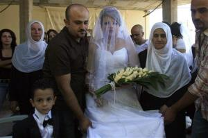 Israeli-Druze bride Waed Munzer, 26, is surrounded by her relatives before leaving her home to marry a Syrian-Druze groom in the Israel-controlled Golan Heights village of Ein Qeinya, Sep. 19, 2007.
